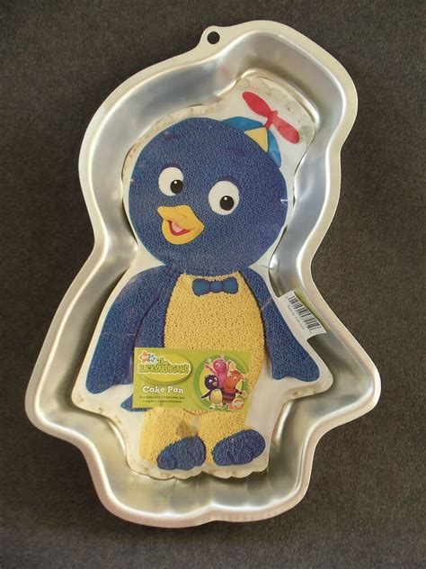 aladdin l cookie cutter pin 1993 wilton lyons barney cake pan 2105 6713 purple