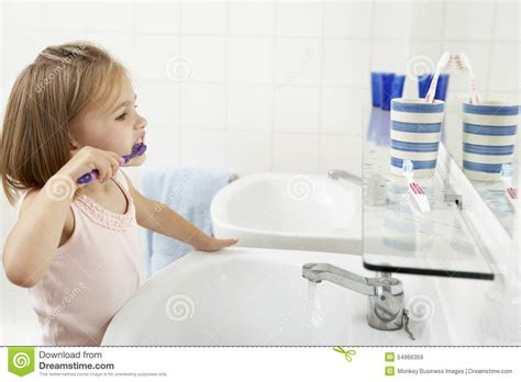 video of girl in bathroom girl in bathroom brushing teeth stock image image 54966359
