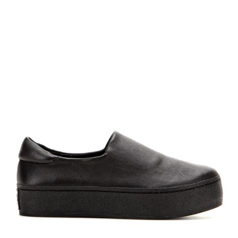 opening ceremony platform leather slip on sneakers in