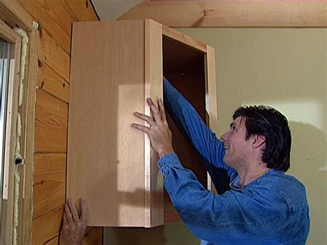how to hang upper cabinets by yourself how to replace kitchen cabinets how tos diy