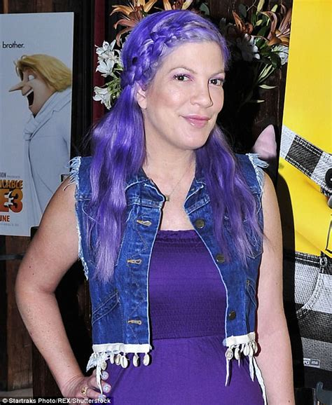 44 year old style tori spelling debuts bright purple hair color at the