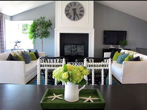 living room with grey walls and green accessories home