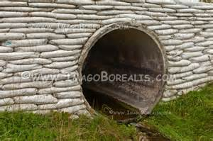 Concrete revetment with storm culvert drainage pipe stock photo