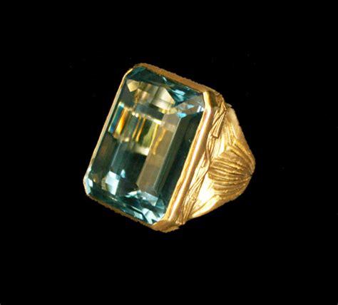 18 karat gold ring set with a blue topaz fj 5561a for