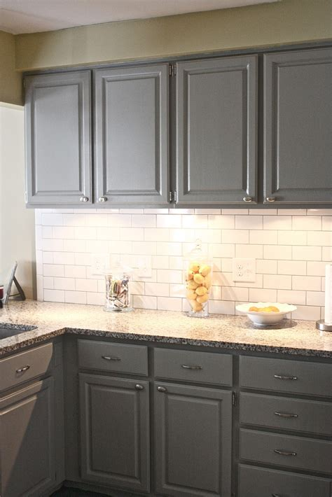 white kitchen tiles white cabinets corian countertops with tile floor