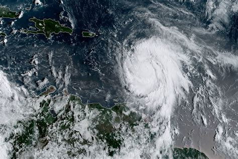 Hurricane L by Hurricane Grows Into A Category 5 And Makes Landfall In The Battered Caribbean