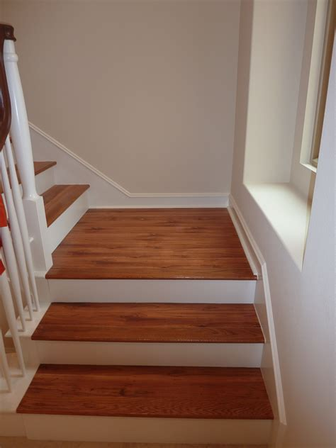 brown color vinyl wood plank flooring on stairs with wall