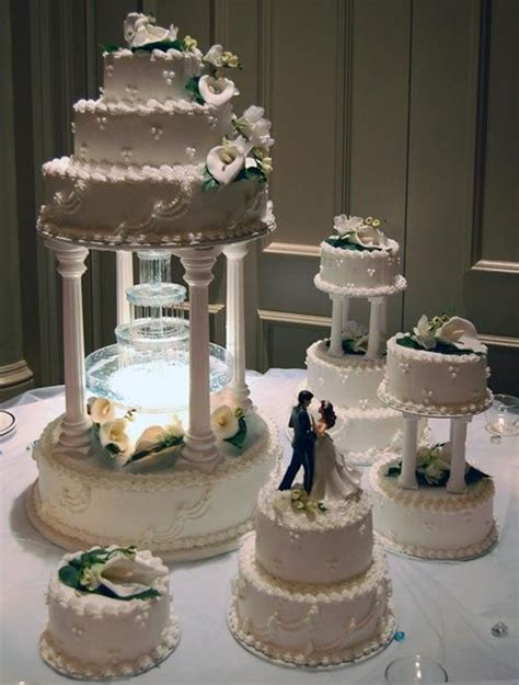 Cake Tier Cake Fontain Plastik Putih four tier water butter wedding cake decorated with wedding cakes