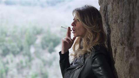 young girl smoking cigarette stock photos images girl smoking cigarette at sunset near the sea stock