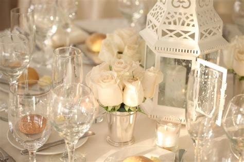 idea for decorating with lanterns and flowers on