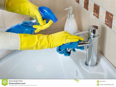 cleaning bathroom sink and faucet stock photo image