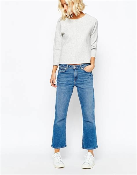 how to wear flare pants flare pants are in style how to wear cropped flare jeans trendsurvivor