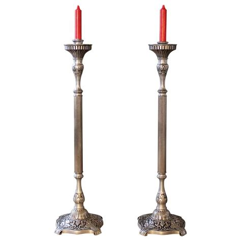 pair of brass works pewter finish candle stands