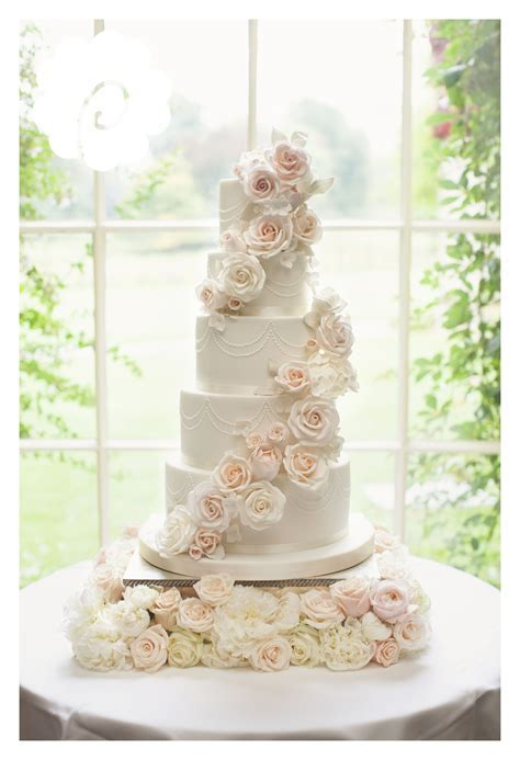 Modern striking sugar rose cascade floral wedding cake