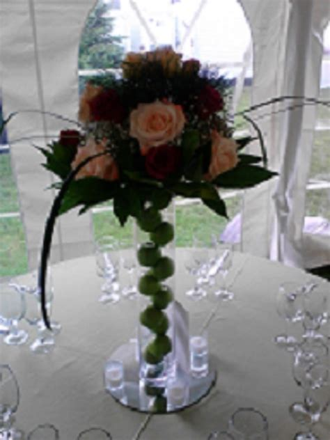 Fresh flower arrangements on a tall vase ? Raji Creations