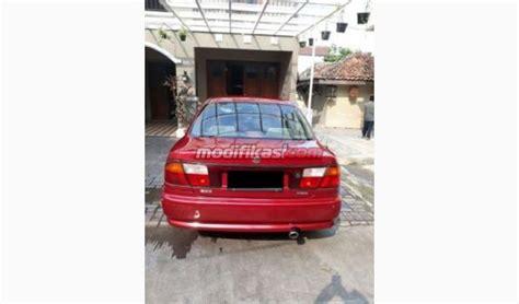 1997 mazda 323 familia manual merah mulus klg nopol 2angka