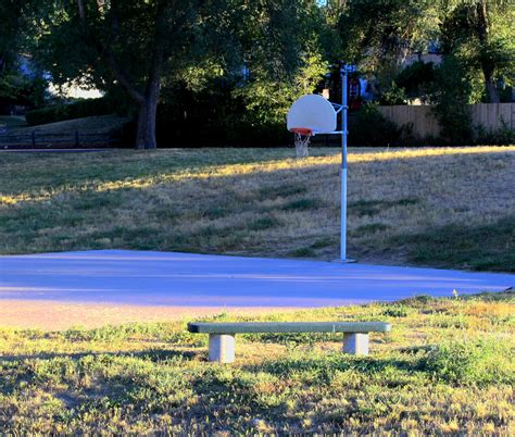 bench court definition park bench and basketball hoop picture free photograph