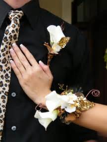 gold boutonniere matching leopardprint and gold corsage and boutonniere