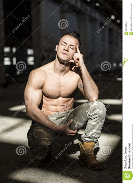 muscular young man  abandoned warehouse royalty