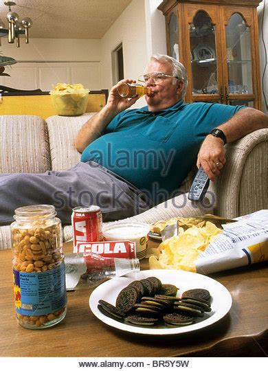 couch potato diet overweight obese man lazy stock photos overweight obese