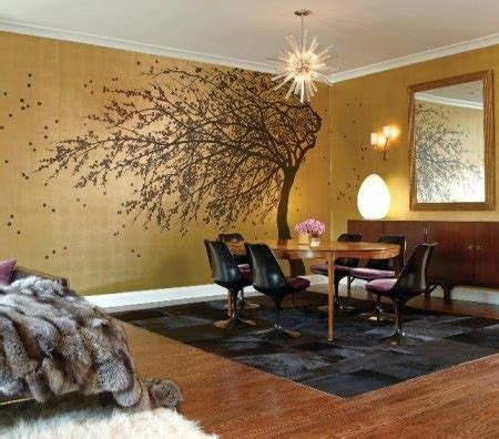 tree in living room metallic gold accent wall with tree in the living room