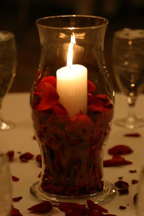 hurricane centerpiece with pillar candle and petals