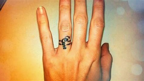 tattoo initials finger 17 best images about wedding ring tattoos on pinterest