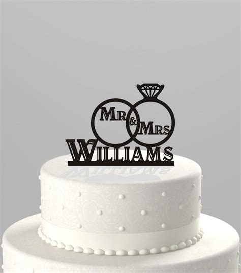 Acrylic Cake Topper Nama wedding cake topper of a wedding ring set with mr mrs and personalized with your name
