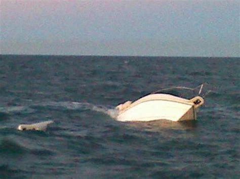 boat sinking lake michigan coast guard rescues boaters on lake st clair before