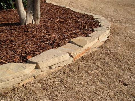 flagstone stack gives your yard definition and keeps your mulch in the beds landscape