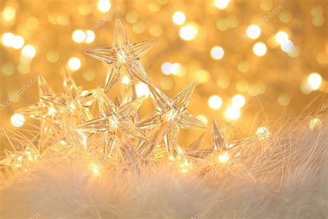star holiday lights with sparkle background stock photo