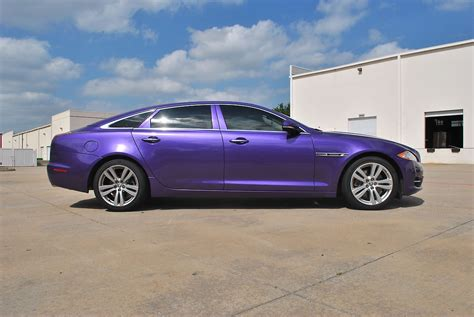purple jaguar jaguar color change black to purple car wrap city