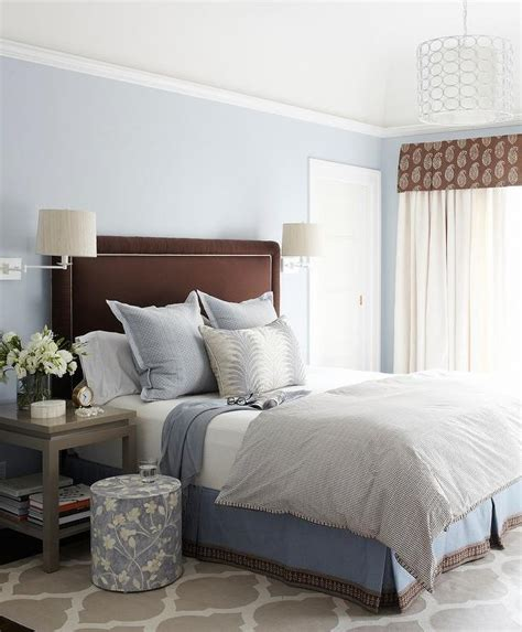 brown  blue bedroom  gray nightstands  gray trellis rug transitional bedroom