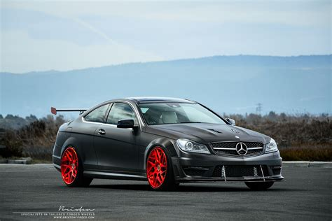black and pink mercedes supercharged mercedes benz c63 amg with red brixton forged
