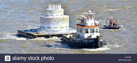 tugboat cake birthday cake with candles close up being towed by tug
