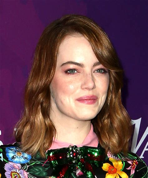swept back casual haircust emma stone medium wavy casual bob hairstyle with side