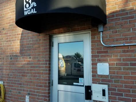 bullnose awnings awning over employee entrance door kreider s canvas