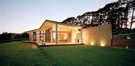 Contemporary gable roof exterior modern with covered patio large windows wood fence