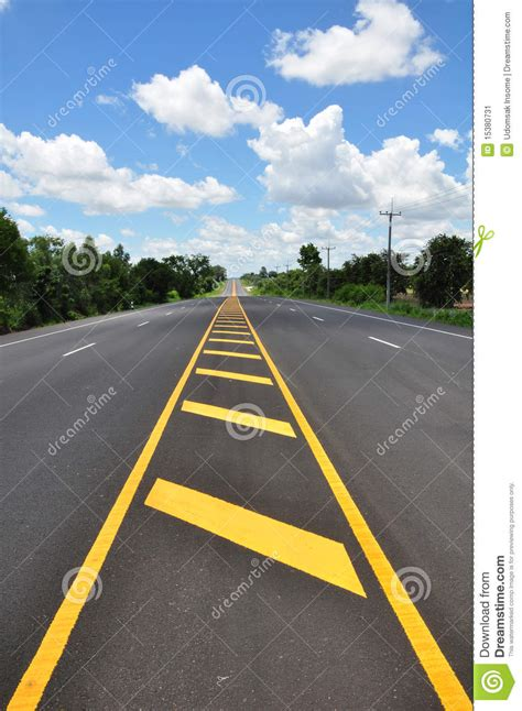 pattern of yellow lines on the roadway yellow line traffic symbol stock image image of grain