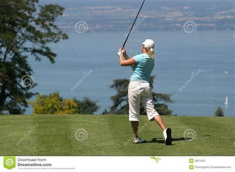 Lady Golf Swing At Leman Lake Royalty Free Stock Photo