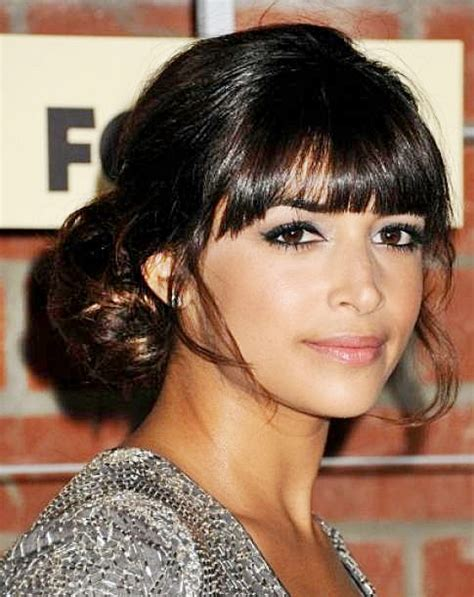hairstyles with bangs and buns hannah simone s low bun hairstyle with blunt bangs prom