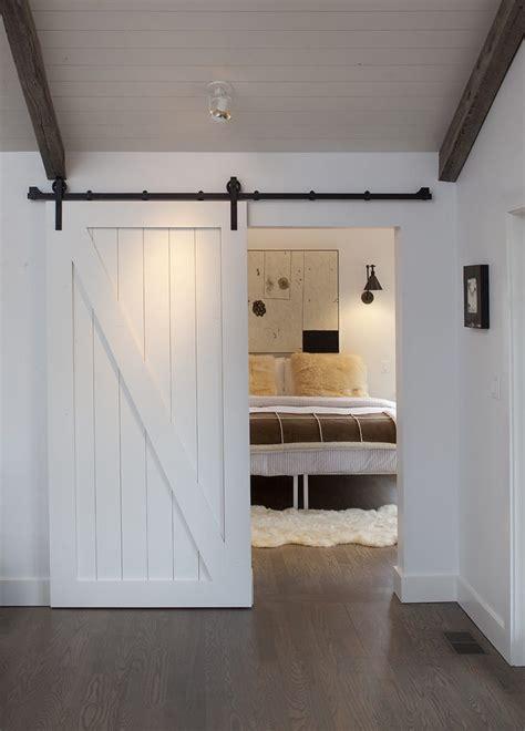lovely Modern Wall Art For Living Room #1: modern-barn-doors-bedroom-farmhouse-with-wood-trim-spot-lights.jpg