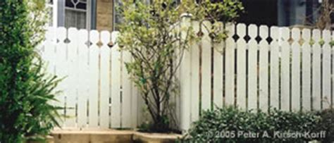 wooden cottage style picket fence a custom fence builder