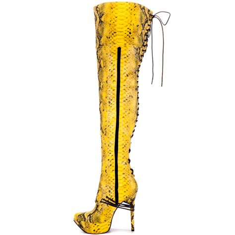 yellow high heel boots two pairs of the knee boots one tarty one a
