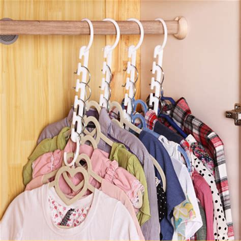 Magic Hanger Clothes Organiser Isi 8 Gantungan Baju Hemat Ruang free shipping 1pcs 3d space saving hanger magic clothes hanger with hook closet organizer home