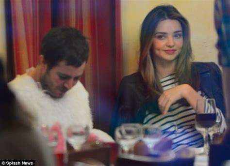 zales commercial actress brunette restaurant table miranda kerr dines with a man disguised in a bunny suit in
