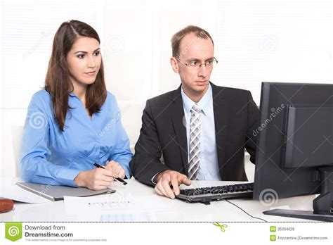 two business sitting at desk royalty free stock
