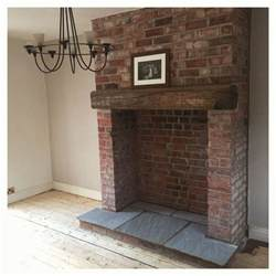exposed brick fireplace with indian stone hearth and
