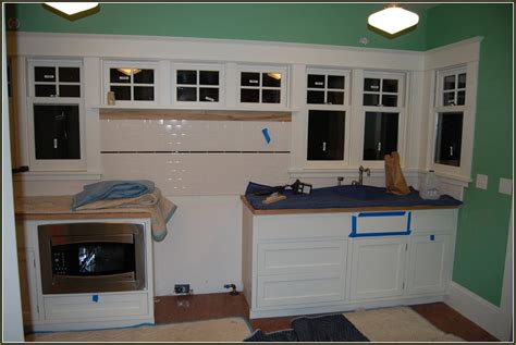 installing kitchen cabinets baseboard heaters home