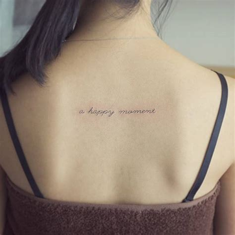 tattoo quotes for upper back upper back tattoo saying quot a happy moment quot